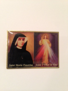 Sister Faustina is shown with a painting recreating the vision of Christ.
